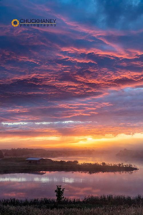 Amazing sunrise clouds over small lake at Cub Creek Recreation Area near Springview, Nebraska, USA