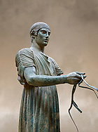 Severe Style Ancient Greek bronze sculpture of a charioteer, 480-460 BC, Delphi National Archaeological Museum. <br /> <br /> The Charioteer is a rare example of Severe Style bronze statue that only servived ancient looters  because it was buried by an earthquake. Plain and austere it mirrors the preveiling aestheics expected from ancient greek atheletes. The statue was probably sculpted following the teachings of Pythagoras of Samos due to its exact symetrical proportions