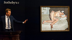 © Licensed to London News Pictures. 26/06/2018. LONDON, UK. Sotheby's Oliver Barker fields bids for ''Portrait On A White Cover'' by Lucian Freud, (Est. £17,000,000 - 20,000,000) which sold for a hammer price of £19,700,000 at Sotheby's Contemporary art evening sale in New Bond Street.  Photo credit: Stephen Chung/LNP