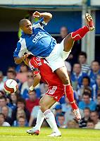 Photo: Ed Godden.<br /> Portsmouth v Liverpool. The Barclays Premiership. 28/04/2007. Portsmouth's Glen Johnson colides with Mark Gonzalez.