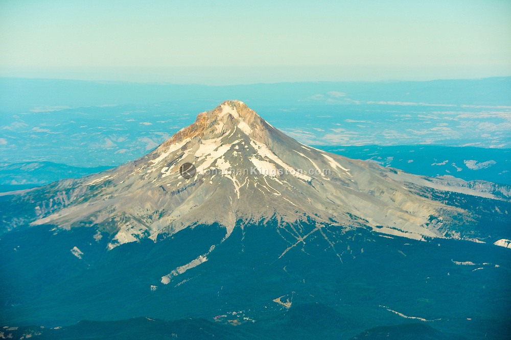 Aerial view of Mount Hood with very little snow on it in the summertime.