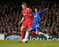Photo: Leigh Quinnell.<br /> Chelsea v Liverpool. UEFA Champions League. <br /> 06/12/2005. Chelseas Paulo Ferreira clears the box in fron t of Liverpools  John Arne Riise