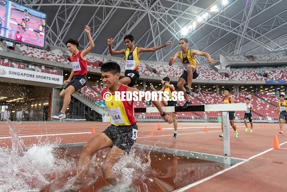 Joshua Rajendran (#244) of HCI sinks into the water during the A Division Boys' 3000m steeplechase final. He went on to finish in second place with a time of 10:36.91. (Photo X © REDintern Jared Khoo)