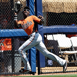 March 20, 2011; Port Charlotte, FL, USA; Baltimore Orioles center fielder Adam Jones (10) catches a fly ball during a spring training exhibition game against the Tampa Bay Rays at Charlotte Sports Park.   Mandatory Credit: Derick E. Hingle