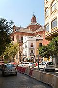 Traffic in street near Iglesia Santa María Magdalena in central Seville, Spain