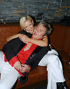"DURAN DURAN LAUNCH THEIR NEW ALBUM ""ASTRONAUT"", SYDNEY, AUSTRALIA 23rd AUGUST 2004-duran duran...SIMON LE BON WITH MODEL & AUTHOR BESSIE BARDOT."