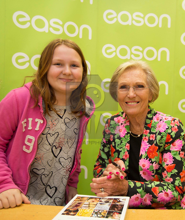 Repro Free: 07/03/2014<br /> Millie Hannessy (10) from Malahide Co Dublin is pictured with Mary Berry pict at the signing of her new book, Absolute Favourites, today in Eason O'Connell Street where dozens of fans queued to have their copy signed by the author and TV personality. Allannah Kearney from Santry and Bianca Rosales presented Mary with some of their Salted Caramel Cupcakes.<br /> <br /> Absolute Favourites is currently on sale in Eason stores nationwide and online at www.easons.com retailing at €31.99 and is part of Easons' Buy One Get One Half Price spring reading offer. Picturte Andres Poveda<br /> <br /> For further information, please contact: <br /> Shane Lennon or Kristin Fox @ Wilson Hartnell<br /> 087 900 0320 / 087 221 1916 <br /> shane.lennon@ogilvy.com / kristin.fox@ogilvy.com