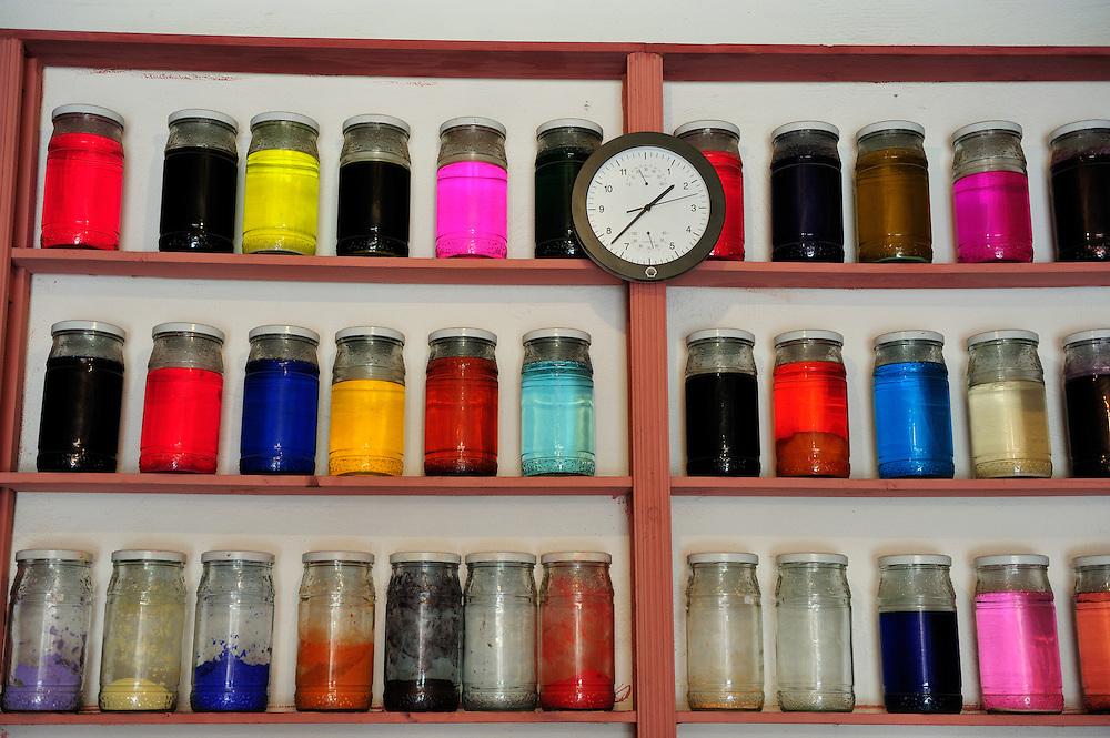 Shelves of dye in a Marrakesh store