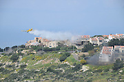 A fire drill in Haifa, Israel using an aircraft to extinguish a forest fire