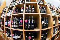 Rows of wine bottles, House of Baden Wine (Haus der Badischen Weine) on Munsterplatz, Freiburg, Baden-Württemberg, Germany