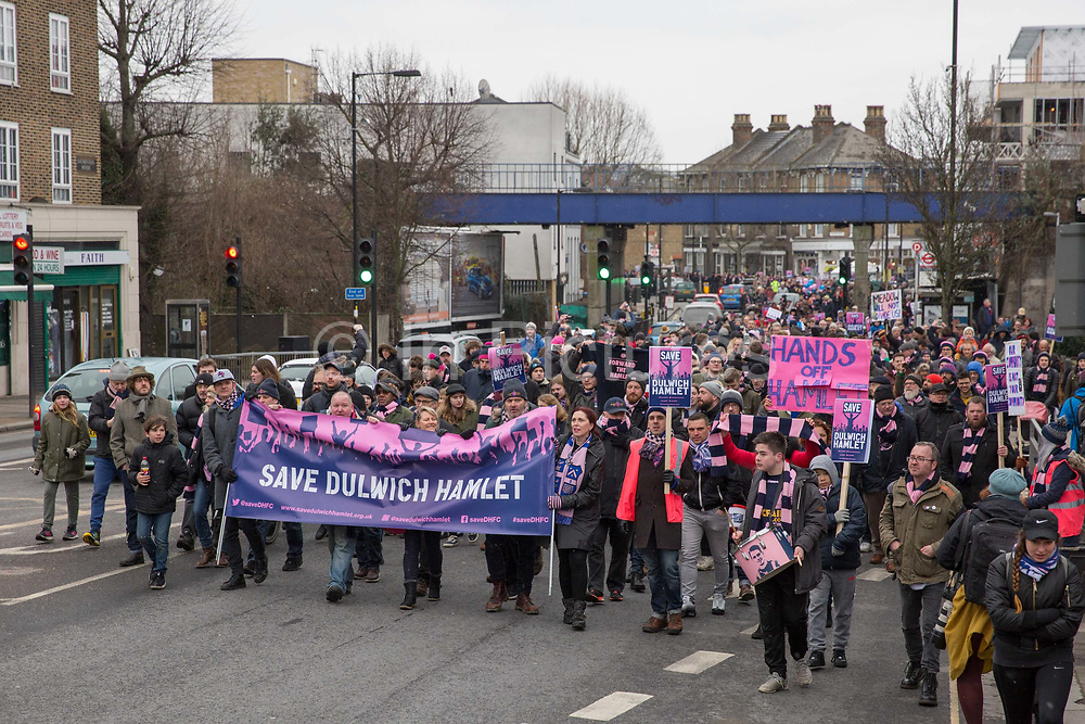Fans and supporters of Dulwich Hamlet Football Club during a protest march from Goose Green to Champion Hill on 17th March 2018 in South London in the United Kingdom. The non-league, South London, club is gaining popularity following recent eviction by Meadow Residential, an American property investment fund, who want to turn the clubs ground, Champion Hill, into luxury flats.