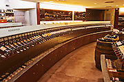A curved display of bottles The Lavinia wine shop in Paris. Probably the biggest wine shop in Paris, with its special temperature controlled section for wines that are fragile and must be stored at cool low temperature.