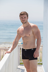 shirtless hunky guy in boxer briefs by the ocean