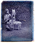 young western girl dressed up in a Asian style clothing France 1900s glass plate