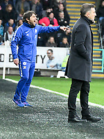 Football - 2017 / 2018 Premier League - Swansea City vs. Chelsea<br /> <br /> Chelsea manager Antonio Conte shouts on the touchline Swansea manager Carlos Carvahal in foreground, at the Liberty Stadium.<br /> <br /> <br /> COLORSPORT/WINSTON BYNORTH