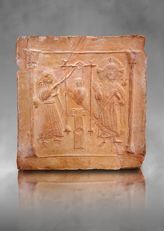 6th-7th Century Eastern Roman Byzantine  Christian Terracotta tiles depicting Christ changing Water into wine - Produced in Byzacena -  present day Tunisia. <br /> <br /> These early Christian terracotta tiles were mass produced thanks to moulds. Their quadrangular, square or rectangular shape as well as the standardised sizes in use in the different regions were determined by their architectonic function and were designed to facilitate their assembly according to various combinations to decorate large flat surfaces of walls or ceilings. <br /> <br /> Byzacena stood out for its use of biblical and hagiographic themes and a richer variety of animals, birds and roses. Some deer and lions were obviously inspired from Zeugitana prototypes attesting to the pre-existence of this province's production with respect to that of Byzacena. The rules governing this art are similar to those that applied to late Roman and Christian art with, in the case of Byzacena, an obvious popular connotation. Its distinguishing features are flatness, a predilection for symmetrical compositions, frontal and lateral representations, the absence of tridimensional attitudes and the naivety of some details (large eyes, pointed chins). Mass production enabled this type of decoration to be widely used at little cost and it played a role as ideograms and for teaching catechism through pictures. Painting, now often faded, enhanced motifs in relief or enriched them with additional details to break their repetitive monotony.<br /> <br /> The Bardo National Museum Tunis, Tunisia. Against a grey art background.