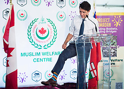 Prime Minister Justin Trudeau shows of his Ramadan color socks after helping prepare food baskets for Project Ramadan at the Muslim Welfare Centre in Scarborough, Ont., on Thursday, June 22, 2017. Photo by Nathan Denette/CP /ABACAPRESS.COM  | 598228_004 Scarborough Canada