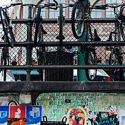 Bikes locked up along a fence line in downtown Seattle, Washington.