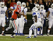 ATHENS, GA - NOVEMBER 23:  Return man Reggie Davis #81 of the Georgia Bulldogs fumbles a punt while Dyshawn Mobley #33 of the Kentucky Wildcats looks on during the game at Sanford Stadium on November 23, 2013 in Athens, Georgia.  (Photo by Mike Zarrilli/Getty Images)