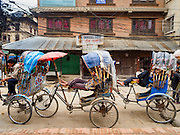 06 AUGUST 2015 - KATHMANDU, NEPAL: Pedicab drivers in the Thamel neighborhood of Kathmandu wait for fares.     PHOTO BY JACK KURTZ