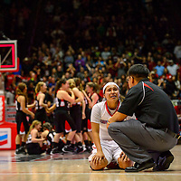 """031414 Adron Gardner/Independent<br /> <br /> Shiprock Chieftain Ashley John (33) listens to coach Larensen Henderson  after losing the girls 3A basketball championship to the Portales Ram 59-62 at The Pit in Albuquerque Friday. """"This is hitting them hard right now,"""" Henderson said. """"But I hope they take it as a lesson for life. It is just a game. They have to learn to let those things go."""""""
