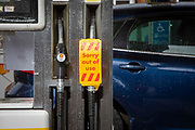 As the fuel crisis in the UK continues this pump has a Sorry out of use sign on it in a Shell petrol station on the 1st of October 2021 in Folkestone, United Kingdom. Almost all the petrol stations in Folkestone have no fuel, this Shell garage took a delivery recently and now has queues over half a mile in both directions but not all the pumps are working. People have been waiting for more than 2 hours to get fuel. Panic buying and long queues outside some petrol stations as the crisis, which has been caused by a lack of HGV drivers available to deliver supplies, continues.