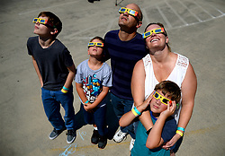 From left, Trevor, Evan, Todd, Cynthia and Ryan Striegel of Fort Mill, S.C. gaze at the solar eclipse from the rooftop of the Discovery Place parking deck on Monday, Aug. 21, 2017. Photo by Jeff Siner/Charlotte Observer/TNS/ABACAPRESS.COM