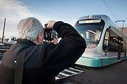 27 DECEMBER 2008 -- PHOENIX, AZ: David Sailors (CQ) from New York, photographs a light rail train Saturday. Metro Light Rail started running Saturday, Dec. 28. The light rail line is 20 miles long and cost $1.4 billion dollars. PHOTO BY JACK KURTZ
