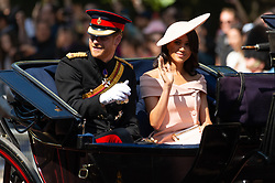 © Licensed to London News Pictures. 09/06/2018. London, UK.  The DUKE OF SUSSEX and The DUCHESS OF SUSSEX rides in a carriage to attend the Trooping The Colour ceremony in London. This years event is part of a weekend of celebration to mark the 92th birthday of Queen Elizabeth II, who is Britain's longest reigning monarch.Photo credit: Ray Tang/LNP