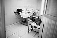 Two midwifery students sleep a bit during their night shift. Karachi, Pakistan