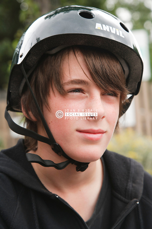 Boy wearing helmet for skateboarding or cycling