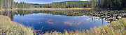 An autumn panorama of South Prairie Lake in the Gifford Pinchot National Forest, WA, USA located on Forest Service Road 66.