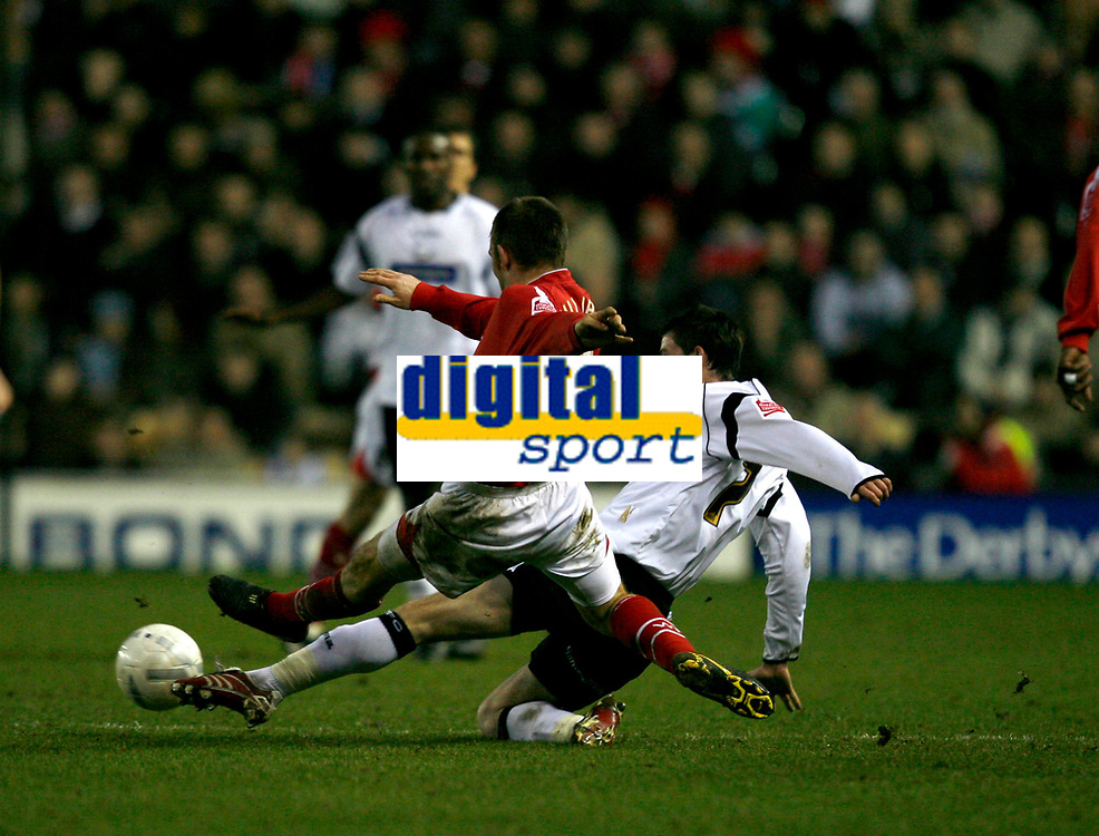 Danny williams of Wrexham (red,8) tackles David Jones (7, white) of Derby County
