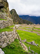 View of the Main Plaza at the Incan ruins of Machu Picchu, with Huayna Picchu rising in the background, near Aguas Calientes, Peru.