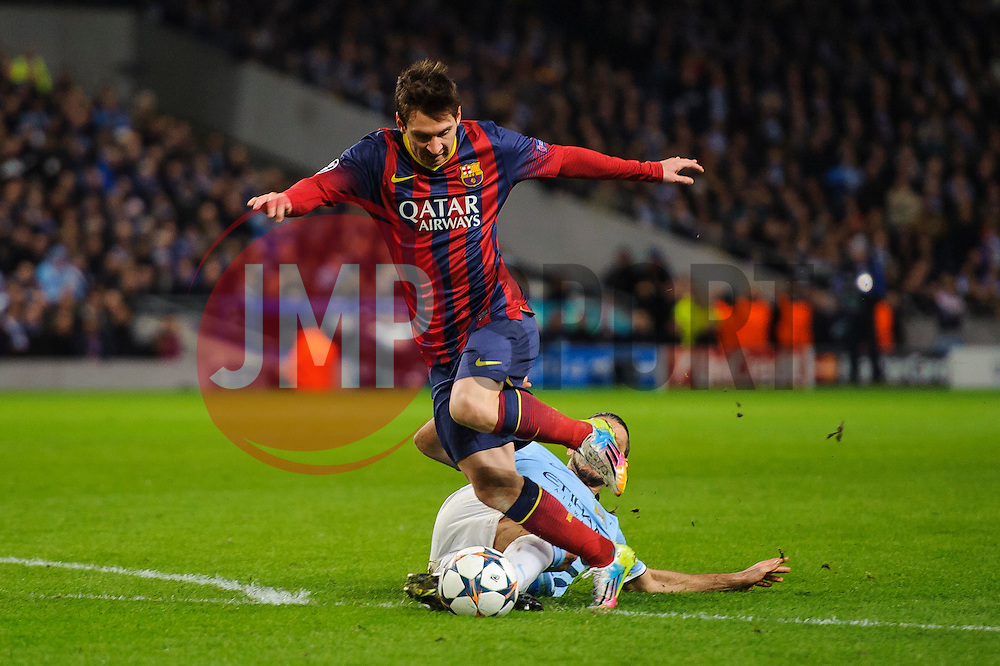 Man City Defender Martin Demichelis (ARG) fouls Barcelona Midfielder Lionel Messi (ARG) on the edge of the box leading to a red card for (Demichelis) and a penalty for Messi, which he converts - Photo mandatory by-line: Rogan Thomson/JMP - Tel: 07966 386802 - 18/02/2014 - SPORT - FOOTBALL - Etihad Stadium, Manchester - Manchester City v Barcelona - UEFA Champions League, Round of 16, First leg.