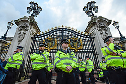 © Licensed to London News Pictures. 15/10/2019. LONDON, UK. Police in attendance as climate activists from Extinction Rebellion lie handcuffed, prior to being arrested, outside the gates to Buckingham Palace during a Grandparents protest.  Activists are calling on the government to take immediate action against the negative effects of climate change.  Photo credit: Stephen Chung/LNP