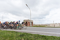 Peloton speed by one of the many war cemeteries that line the route - Women's Gent Wevelgem 2016, a 115km UCI Women's WorldTour road race from Ieper to Wevelgem, on March 27th, 2016 in Flanders, Netherlands.