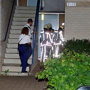 NLD/Huizen/20060611 - Brand Schieland 2 Huizen, voordeur met benzine in de brand gestoken