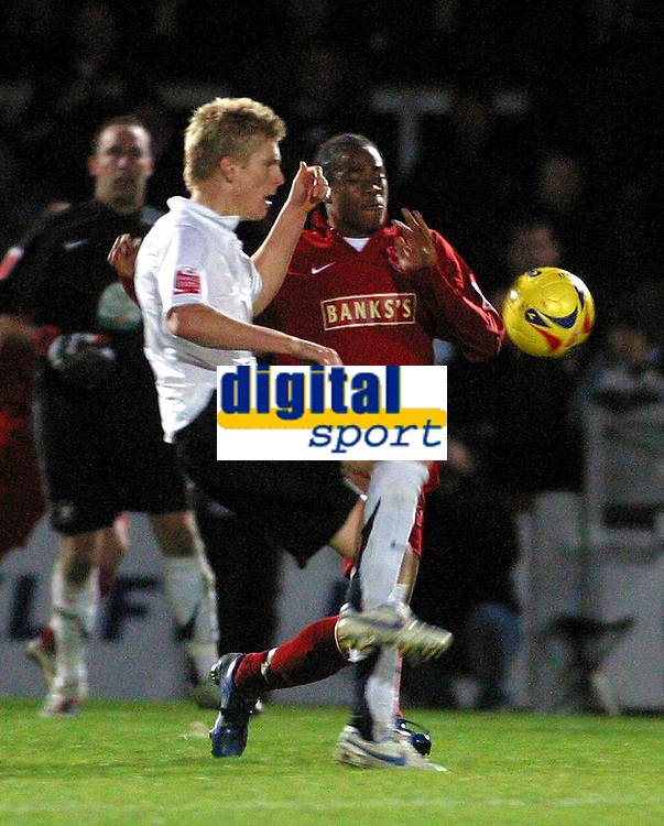 Photo: Dave Linney.<br />Hereford United v Walsall. Coca Cola League 2. 18/11/2006. Walsall's Hector Sam battles with Alex Jeannin.