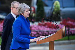 London, UK. 24 July, 2019. Theresa May, accompanied by her husband Philip, addresses the nation outside 10 Downing Street before proceeding to Buckingham Palace to tender her resignation to the Queen.