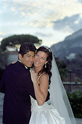 bridal couple cheek to cheek during a sunset in Italy