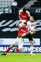 Michael Ihiekwe and Richard Wood of Rotherham United during a challenge for possession against Matthew Clarke of Derby County - Mandatory by-line: Ryan Crockett/JMP - 16/01/2021 - FOOTBALL - Pride Park Stadium - Derby, England - Derby County v Rotherham United - Sky Bet Championship