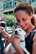 Israel, Tel Aviv a woman looking fondly at a young puppy