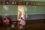 Nun creating shadow behind curtain, Compassion and Peace Nunnery, Nyaung Shwe