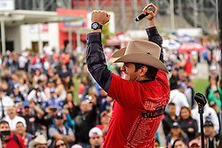 FONTANA, CA - MAR 22 Regional Mexican singer and Latin Grammy nominee El Dasa performed a pre-race concert at the NASCAR Sprint Cup Series the Auto Club 400. After his performance he attended the media and his loyals fans. Chiquis Rivera ( Daughter of Jenny Rivera). Stopped by after the concert to show her support for El Dasa. He also was part of the NASCAR drivers introductions where he met all of the NASCAR Sprint Cup Series drivers competing at the Auto Club 400. Including Danica Patrick, Jeff Gordon, Jimmy Johnson, Tony Setwart and the pole winner Kurst Busch. He shared the stage with Actor Eric Stonestreet of the TV show modern family and other celebrities. 2015 Mar 22. Byline, credit, TV usage, web usage or linkback must read SILVEXPHOTO.COM. Failure to byline correctly will incur double the agreed fee. Tel: +1 714 504 6870.