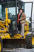 Martha Moore, owner of McCormick Works, Inc. (formerly McCormick Asphalt), poses for a photo near a piece of construction machinery on Thursday, February 6, 2014, in Mulberry, Arkansas.