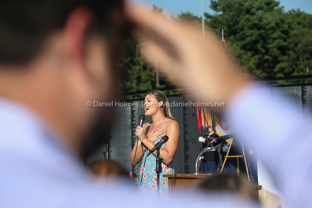 """(8/22/19, BELLINGHAM, MA) Ayla Brown sings the National Anthem during the opening ceremonies for """"The Wall that Heals"""" at Memorial Middle School in Bellingham on Thursday. [Daily News and Wicked Local Photo/Dan Holmes]"""
