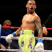 KISSIMMEE, FL - JULY 15: Orlando Cruz yells at Alejandro Valdez during a boxing match at the Kissimmee Civic Center on July 15, 2016 in Kissimmee, Florida. Cruz was the first professional boxer to announce himself as gay and recently lost four friends in the Pulse Nightclub shooting in Orlando, he dedicated this match to his lost friends and won the bout by TKO in the 7th round.  (Photo by Alex Menendez/Getty Images) *** Local Caption *** Orlando Cruz; Alejandro Valdez