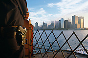 As the Statten Island ferry nears the business district and skyscrapers of Manhattan Island, a New York City Police Department (NYPD) police officer stands guard at the very front (the bow) of the boat. It is approximately ten days after the 9/11 attacks and with pistol safely holstered and arms folded, he can see the settling dust from Ground Zero beyond the safety chain, where the Twin Towers once stood. It is a bright day and behind the policeman, commuters are already returning to work because normality is a priority for those affected by disruption and fear.