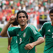 Aldo De Nigris, Mexico, (centre) celebrates after scoring during the Mexico V Wales international football friendly match at MetLife Stadium, East Rutherford, New Jersey, 23rd May 2012. Photo Tim Clayton
